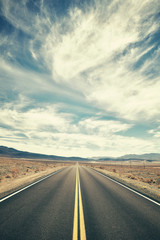 Vintage toned desert road in Death Valley, travel concept, USA.