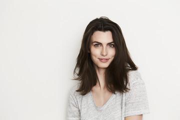 Beautiful brunette woman smiling, portrait