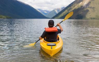 Man paddling kayak in mountain lake, Lake Rotoiti, New Zealand