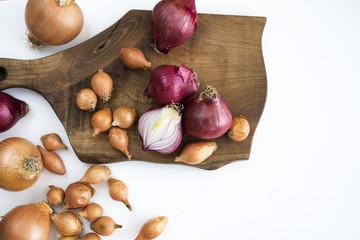 Ripe onions on chopping board