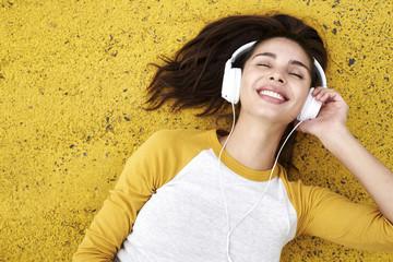 Beautiful woman lost in music on headphones