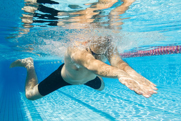 Breaststroke swimming man under water