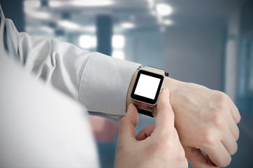 Man using smartwatch with e-mail notifier