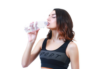 A fitness girl drinks water