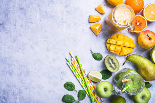 Green and yellow smoothie in mason jar. Top view concrete table