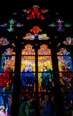 Religious stained glass in St Vitus Cathedral in Prague