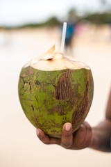Coconut and Coconut Water in Hand