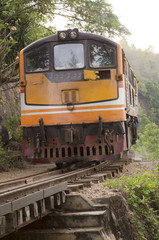 Moving train at death railway, Kanchanaburi, Thailand