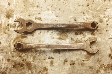 Sepia toned image of old wrenches