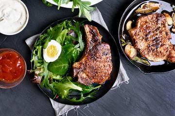 Roasted pork steak with green salad