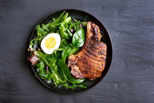 Grilled pork steak with green salad