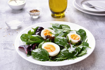 Salad with eggs and greens