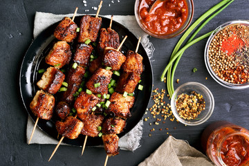 Bbq meat on wooden skewers on plate