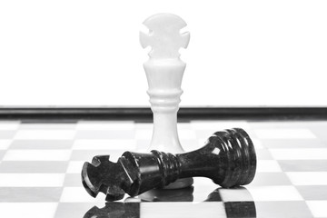 Black and white chessmen on chessboard