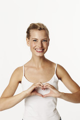 Beautiful woman with heart shaped hands, portrait