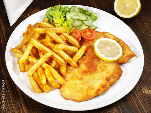 wiener schnitzel mit pommes frites und salat stock photo and royalty free images on fotolia. Black Bedroom Furniture Sets. Home Design Ideas
