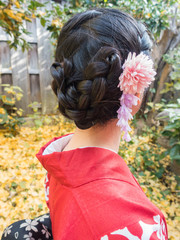 traditional clothes and Hair Style, red kimono, closeup portrait of back view in the garden.