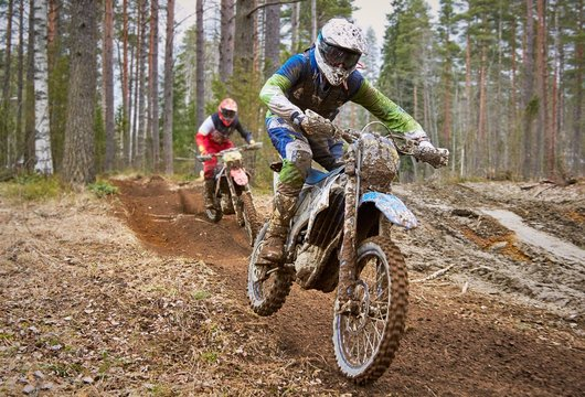 Motocross drivers in competition on the enduro race track