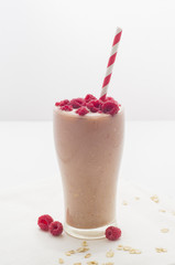 Useful and tasty raspberry cocktail with banana and oatmeal