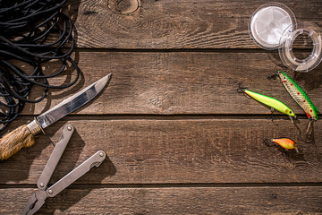 Accessories for fishing on the background of wood. Top view