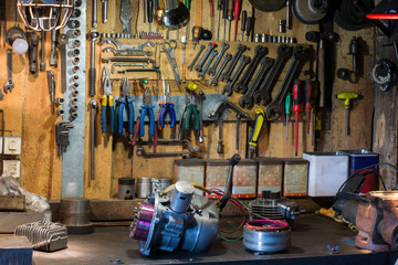Motorcycle parts and tools on the desktop in the garage