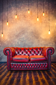 Red sofa couch in vintage room with lamps