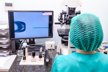 Embryologist adding sperm to egg in laboratory of reproductive clinic. Selective focus