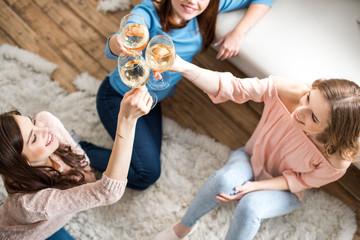 Women cheering with wine