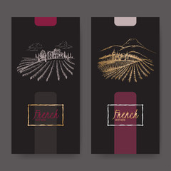 Set of two wine labels with vineyard landscapes.