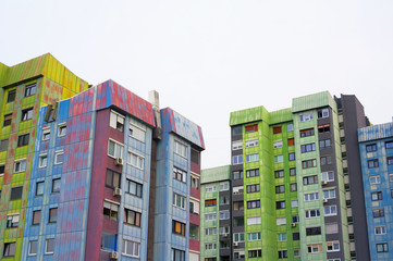 Colorful block of flats in Slovenian city - old and ugly architecture and residential building. Housing project was made in style of brutalism in era of socialist Yugoslavia