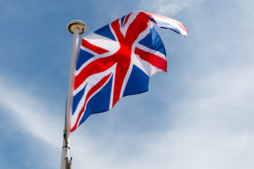 English United Kingdom flag floats on top of mast