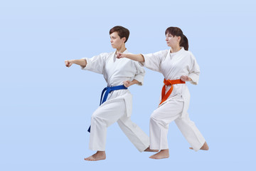 With blue and orange belt athletes train punch arm