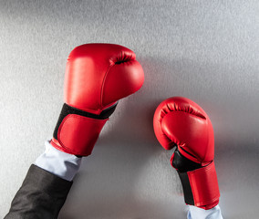 concept of frustration or office competition for boxing businessman