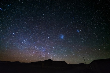 The majestic Magellanic Clouds, outstandingly bright, captured from the Andea highlands in Bolivia, South America.