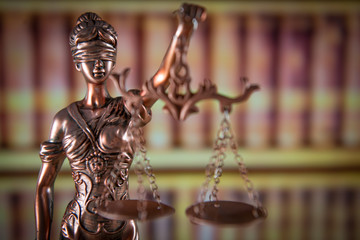 Law concept Gavel and Lady of Justice on wooden table,  united kingdom flag