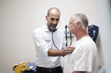 Doctor checking patient's heartbeats