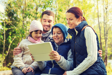 happy family with tablet pc at camp