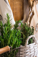 Provence rustic interior, fresh herbs, wood cutting board, linen towel, glass bottles, baskets, pantry style