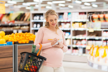 pregnant woman with shopping basket at grocery