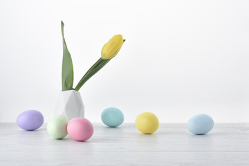 Easter eggs with yellow tulip