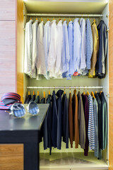 Wardrobe room with an open in the closet