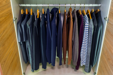 Wardrobe with jumpers and pullovers