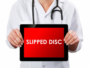 Doctor showing digital tablet screen.Slipped Disc