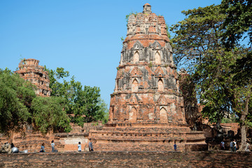 Sunny day n the ruins of the ancient Buddhist temple Wat Mahathat. Ayutthaya, Thailand