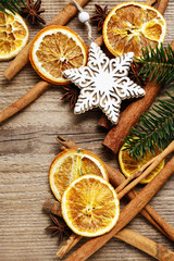 Christmas background with cinnamon sticks, dried oranges and fir branch.