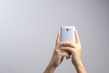 Hand taking a photo or video by mobile phone