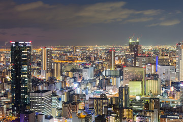 Night lights, Osaka central business downtown aerial view, Japan