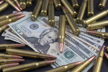 Pile of bullets and American Money