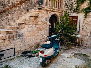 Retro Scooter for hipsters on the streets of Croatia and Montenegro. A small malotrade moped.