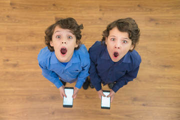The two surprised twin phone. View from above